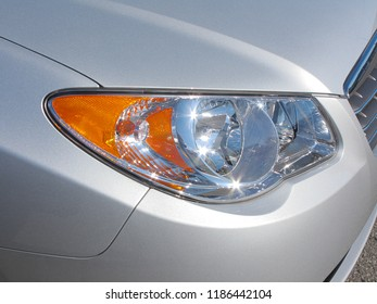 Background for auto dealer selling a new car or refreshing lights after fogging damage