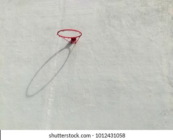 A background of basketball loop with shadow on the cement wall