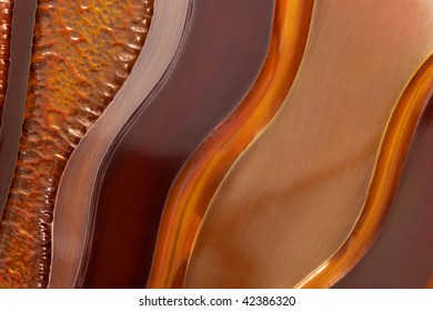 Background of beaten copper textures, in abstract waves.
