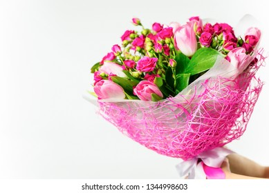 background beautiful bouquet of pink wild rose and pink tulip