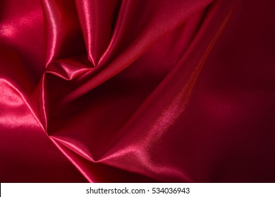 Background from beautiful red satin fabric
