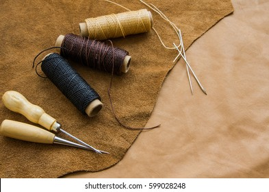Background beige brown leather, craft tools