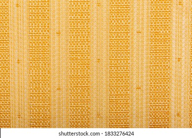 Background of beige fabric with vertical stripes. Abstract blank beige striped background, fabric texture, yellow knitted fabric, cotton, wool. Grunge is rough. Seamless pattern