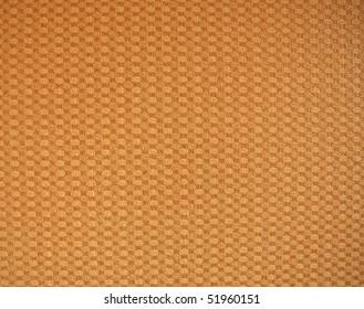 Background of beige vinyl wallpaper.
