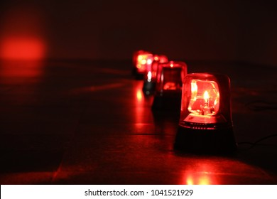 Background with big red flashing alarm lights.