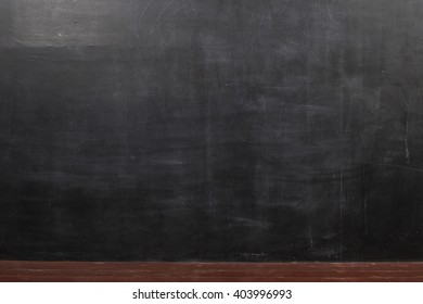 Background of black blackboard and brown wooden floor