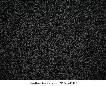 Background of black coil car floor mat  texture