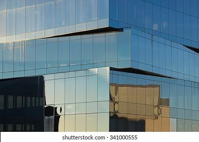 Background of black glass windows.Black glass building