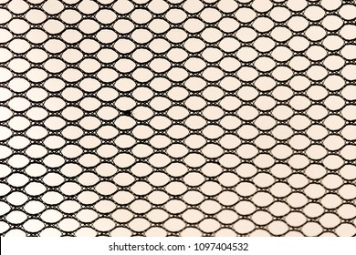background, black synthetic fabric with holes