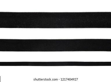 Background with black velvet ribbons on white background