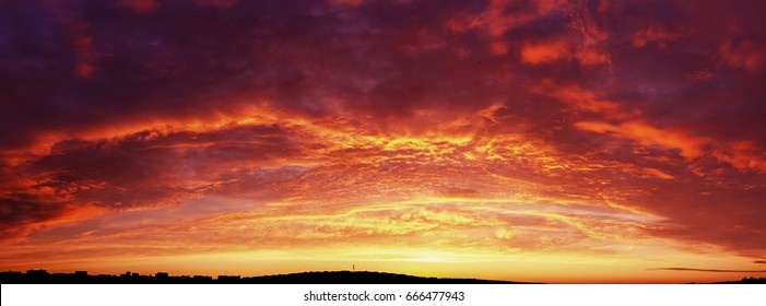 Background of the blood red evening sky and clouds