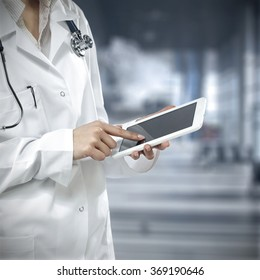 background of blue hosptial interior with tablet