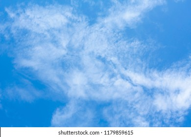 Background of blue sky and white clouds in a summer day.