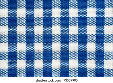 background of blue and white check picnic tablecloth fabric
