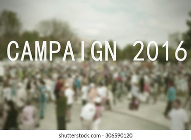 Background blur of crowd at political rally in the United States holding signs and carrying US flags for upcoming election cycle in 2016 presidential campaigns. Vintage filter and message added