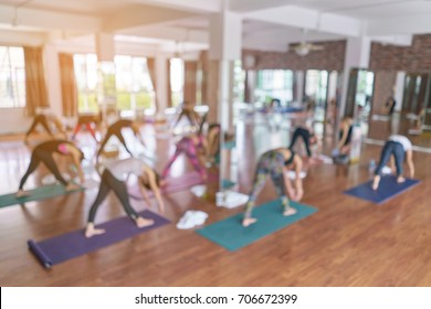 Background blur. Group girl yoga in yoga studios.