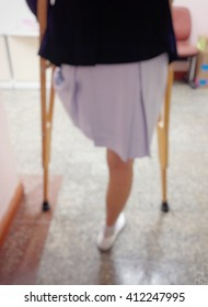 Background blur the patient using crutches to walk.