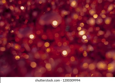 Background blur texture boke, violet, yellow, pink, six sides, round. Defocused abstract red christmas background dark tone