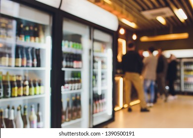 Background Blurred Defocused Beers are cooling in fridge, freezer or refrigerator shelf. Defocused Blurry Night life, Night Club, Bar, Pub, Store or Grocery Background concept image.