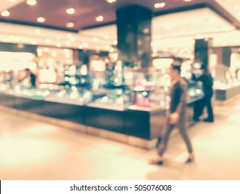 Background blurred jewelry shop and movement  in the shopping arcade.