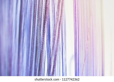 Background blurred. Purple rope in the Studio. Abstruct