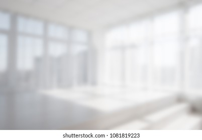 Background of blurred White empty light room with big panoramic windows