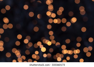 Background bokeh of sparkling defocused party lights twinkling in the darkness conceptual of a celebration, Christmas or New Year