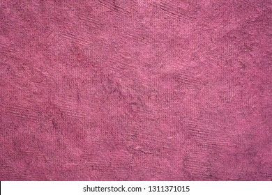 background of  bordeaux  Huun Mayan handmade paper created  by Mayan artisans throughout the Yucatan Peninsula of Mexico