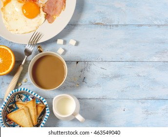 Background breakfast fried eggs, coffee and toast