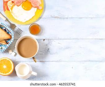 Background breakfast fried eggs, coffee and orange