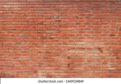 The background of the brick wall with dark orange is beautifully arranged. Ancient wall Grunge background The backdrop may be used in interior design.