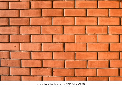 Background - brick wall. The masonry walls of the building.