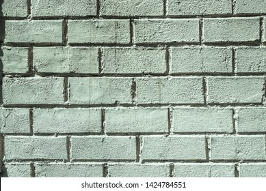 Background brick wall mint color.