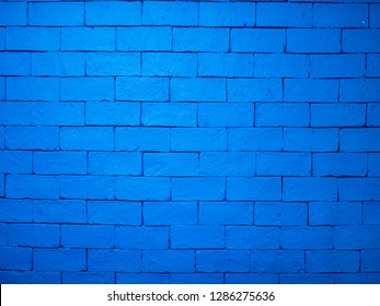 Background of brick wall paint in bright blue color.