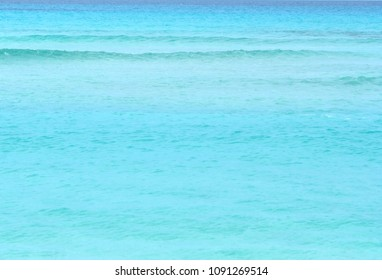 Background of a bright turquoise sea water. Spain