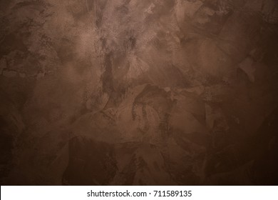 Background. Brown, chocolate paint on the wall. Rough strokes of the master.