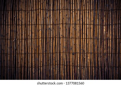 Background of brown grunge cane fence texture