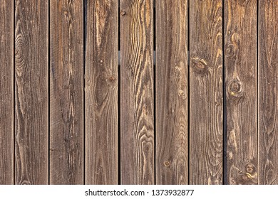 Background of brown vertical boards. Blank background for layouts. Wood texture.