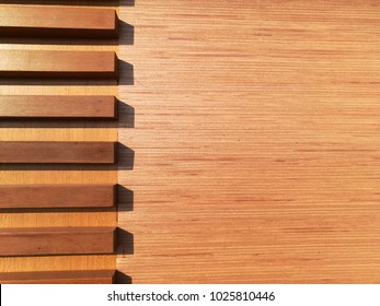 The background is a brown wooden slats and slat.