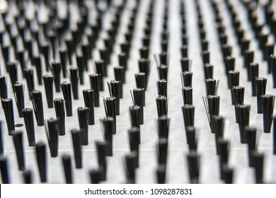 background of brush tips arranged on a metal plate for metalworks, shallow focus