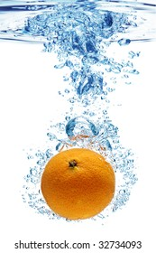 A background of bubbles forming in blue water after orange is dropped into it.