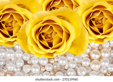 background from the buds of orange roses and pearls