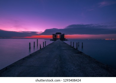 The background of the building that is built in the middle of the sea, is a viewpoint or a relaxing corner for travelers, tourists and the atmosphere of the night sky by the sea.