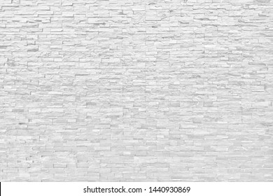 Background of building white brick wall pattern block vintage wallpaper.Clean white wall tone