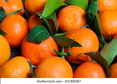 background Bunch of fresh tangerines oranges on market.