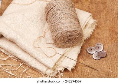 Background of burlap and rope with needle