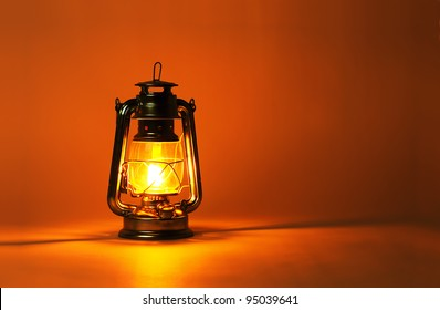 Background burning kerosene lamp, concept lighting
