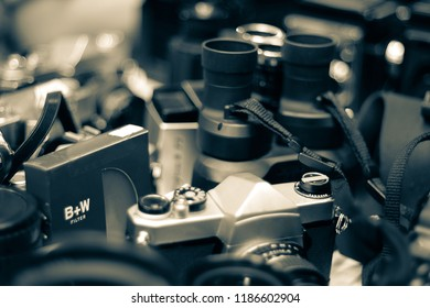 Background of camera, lens and filter in vintage color