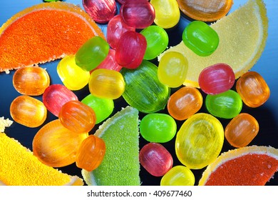 background with candies, lollipops and gummies. Colorful sweets, top view