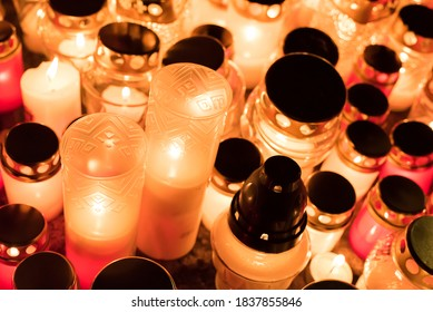 Background with lot of candles lights in autumn evening. Burning candles in memory of the dead soldiers.